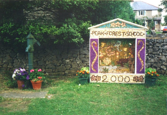 Well Dressing, a custom of decorating the village well each year, still practiced in the Peak District (day 45)