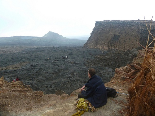 The edge of the caldera; the lava lake lies in a crater (unseen) at the foot of the cliff on the right of the photo, five minutes walk from this point