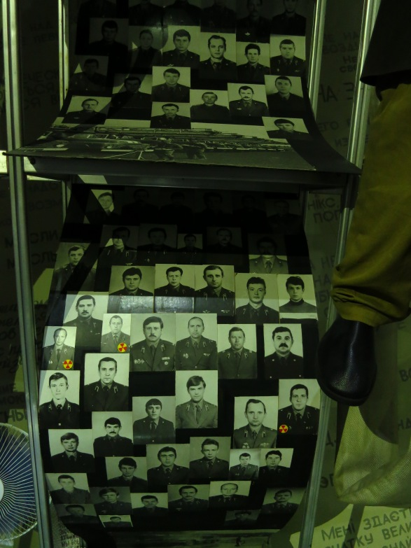 Photos of workers who died after trying to contain the accident are chillingly marked with asmall 'radiation' sign
