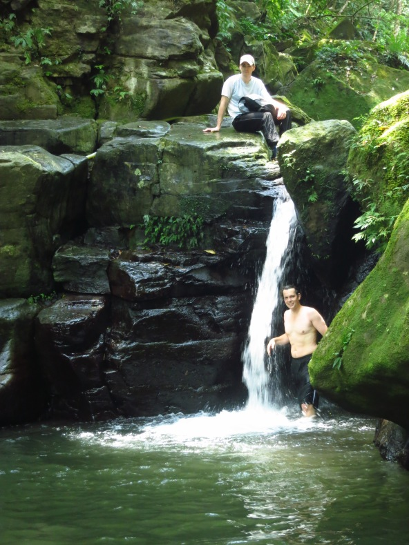 The first waterfall makes a refreshing natural shower on a hot day