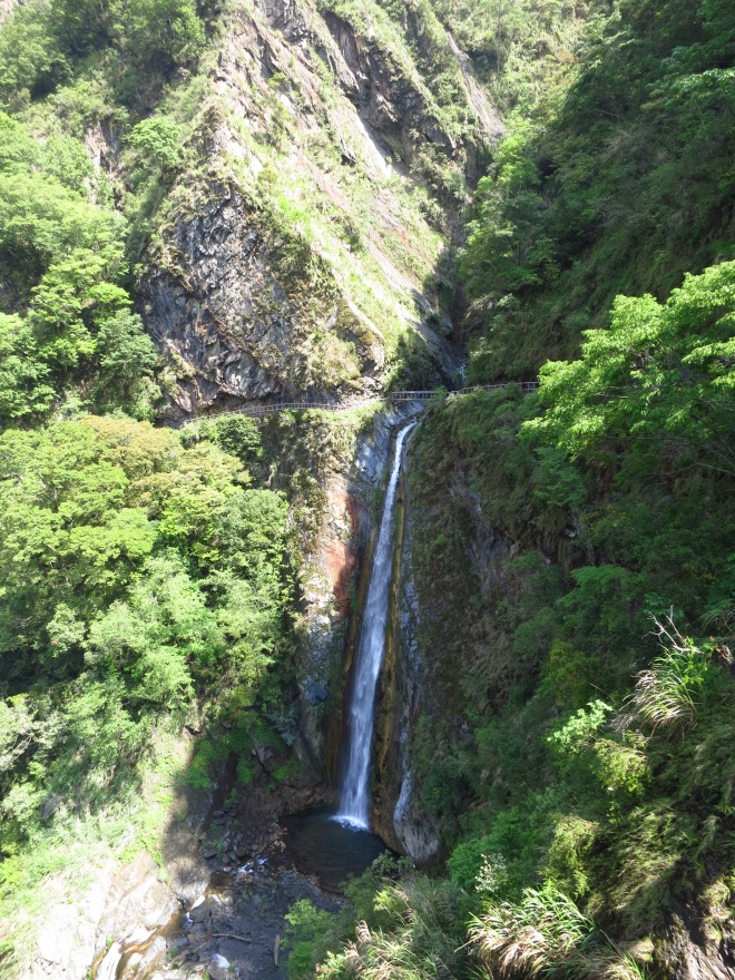 The larger lower fall at Cloud Dragon Waterfall is directly beneath the path, which crosses the stream at the head of the fall by a footbridge