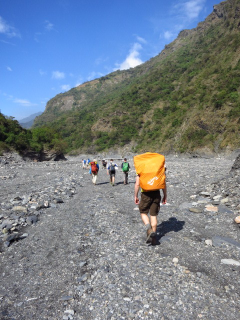 Heading back along the riverbed to the trailhead at the end of the road